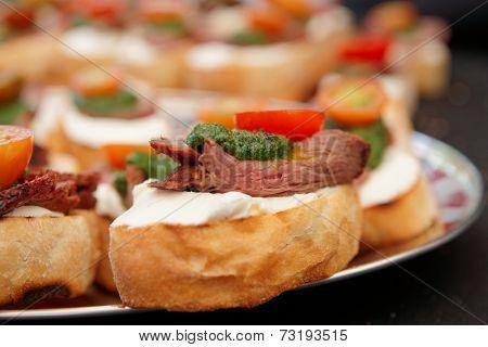 Bruschettas with beefsteak and pesto sauce