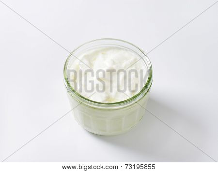 glass of kefir on white background