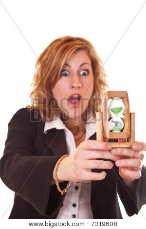 Businesswoman Holding Hourglass