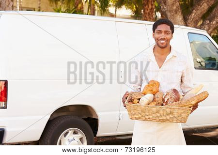 Baker Delivering Bread Standing In Front Of Van