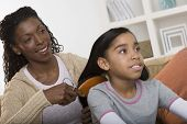 picture of pre-adolescents  - Mother brushing daughter hair - JPG
