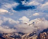 picture of himachal pradesh  - Snowcapped summit top of mountain in Himalayas in clouds - JPG