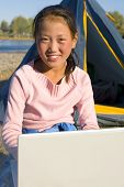 image of mongolian  - Happy Mongolian girls with laptop at campsite - JPG