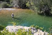 stock photo of fly rod  - Upper view of fly fisherman fly - JPG