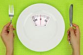 pic of light weight  - Hands and plate with weighing scale on the table - JPG