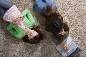 pic of pre-adolescent girl  - Two girls on the floor with MP3 player and laptop - JPG