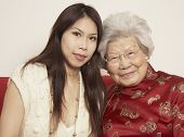 stock photo of grandmother  - Asian grandmother with adult granddaughter smiling - JPG