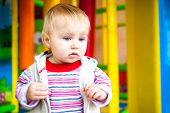 stock photo of montessori school  - little girl in the classroom early development plays with toys - JPG