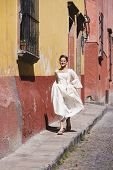 pic of quinceanera  - Hispanic girl on sidewalk in Quinceanera dress - JPG