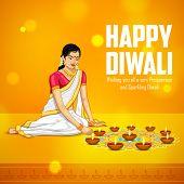 pic of diya  - illustration of woman burning diya for Indian festival Diwali - JPG