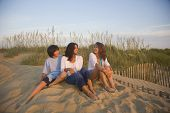 pic of filipina  - Asian woman and children sitting on beach - JPG