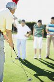stock photo of foursome  - Senior Asian man playing golf - JPG