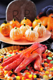 image of amputation  - some plates with different Halloween food - JPG