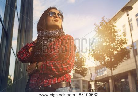 Young Female Walking By The Shopping Street