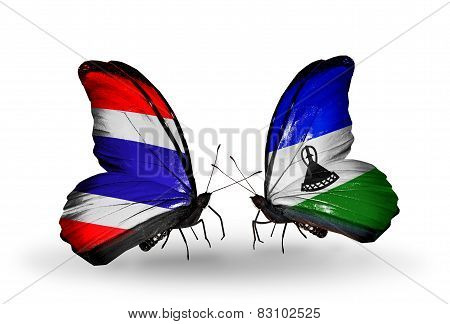 Two Butterflies With Flags On Wings As Symbol Of Relations Thailand And Lesotho