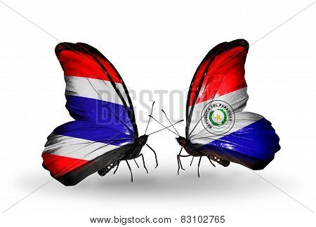 Two Butterflies With Flags On Wings As Symbol Of Relations Thailand And Paraguay