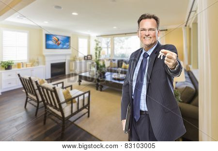 Smiling Male Real Estate Agent Handing Over Keys Standing in Beautiful Living Room.