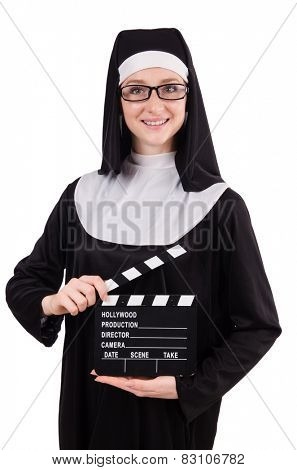 Young nun with clapperboard isolated on white