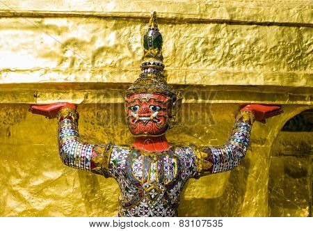 Close-up of a demon guardian supporting Wat Phra Kaew, Bangkok, Thai