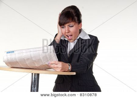 businesswoman surprised reading a newspaper
