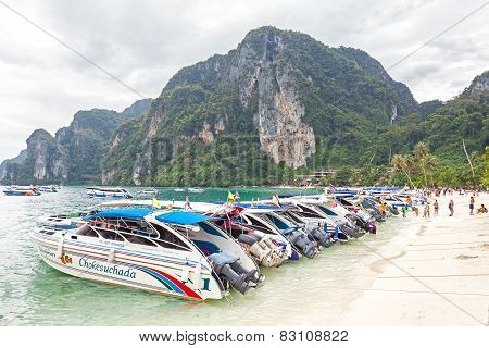 Speed boats and drivers waiting for tourists on the beach.