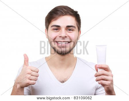 Smiling young man with toothpaste isolated on white