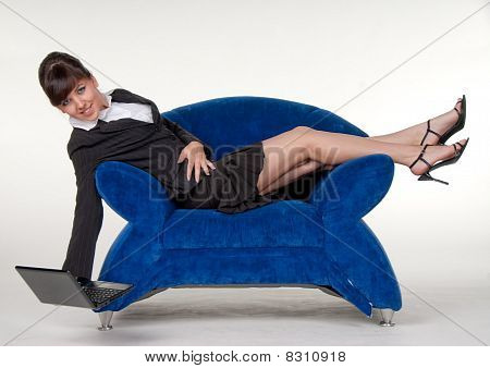 Sexy secretary in blue sofa
