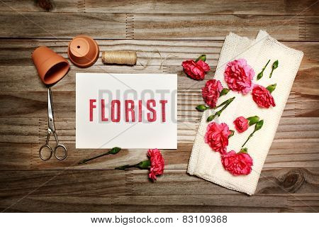 Florist Theme With Flowerpots, Scissors, And Carnation Flowers