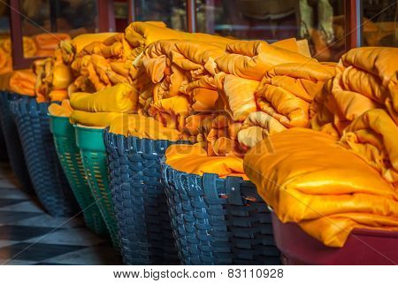 Buddha sarong in baskets placed in the temple Asia