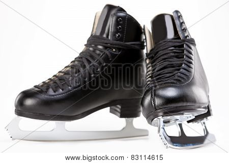 Pair Of Black Professional Figure Skates With Sharp Blades Over White Background