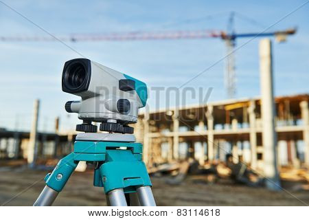 Surveyor equipment optical level outdoors at construction site