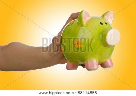 Hand with piggybank on white background