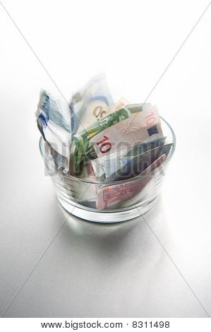 Euro bills in a bowl