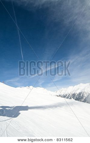 Shadow Of Snow Gun At Ski Slope