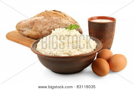 Dairy products with eggs and loaf of bread isolated on white