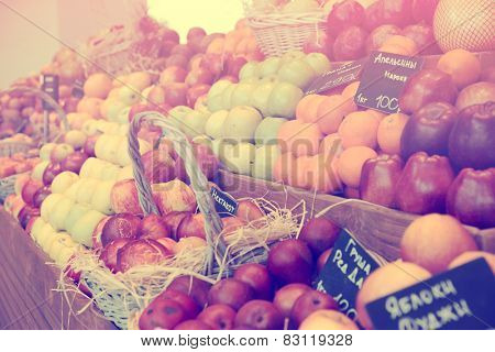 Shelf with fruits on a farm market, toned image