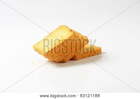 crispy rusks on white background