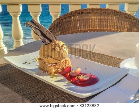Mallorquin Almond Cake With Icecream And Chocolate Served In A Restaurant