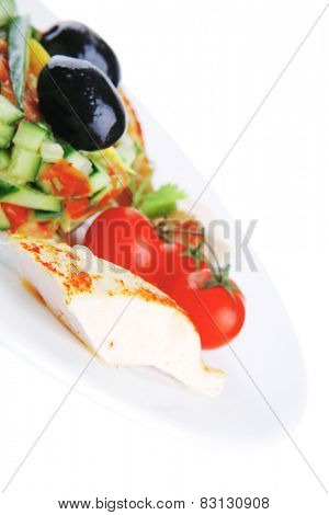 grilled chicken drumstick served on white plate