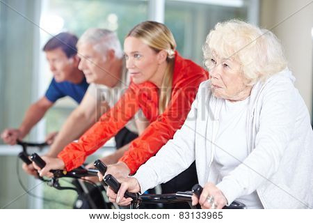 Senior group together in a spinning class in rehab care center