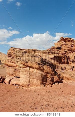 Scenic weathered orange rock in stone desert