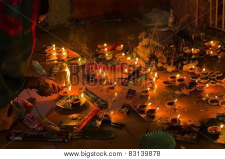 Hindu worshiper lighting incense stick