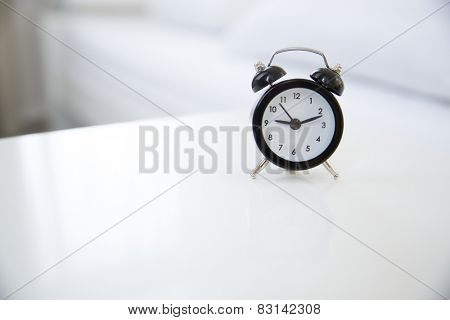 Classic style alarm clock on the table