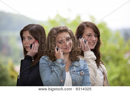 happy teenagers with cellphones