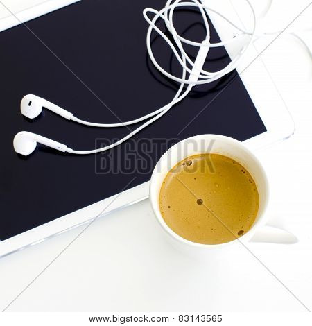 Digital Tablet And Earphone And White Coffee Cup On White Background