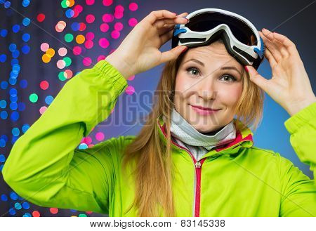 Woman in ski clothing on christmas lights