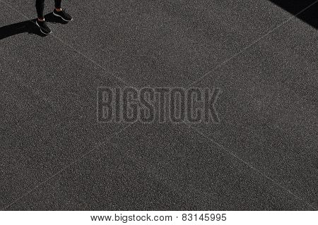 Unrecognizable Runner Standing At Side Position. Top View Jogging Man Taking A Break During Training