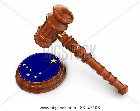 Wooden Mallet and flag Of Alaska (clipping path included)