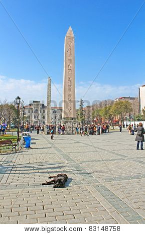 ITourists near Obelisk at hippodrome in Istanbul, Turkey