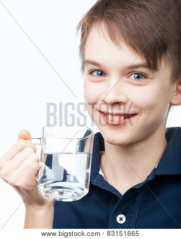Cheerful boy holding cup of water on white background
